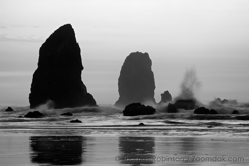 Waves batter against the rocks during a winter evening in Cannon Beach, Oregon.