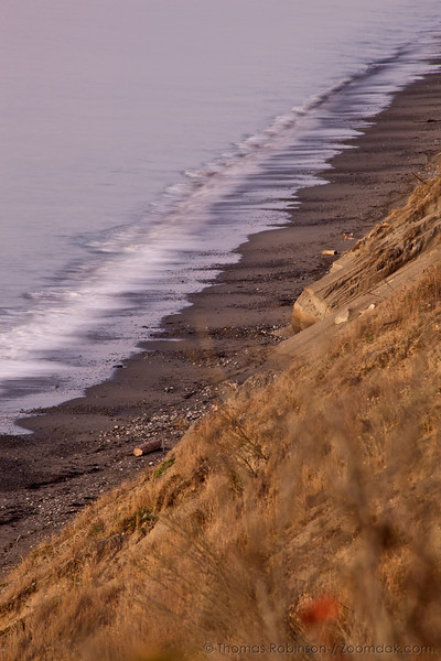 A slow exposure shows the waves along the Dungeness Spit in the evening glow.