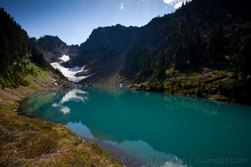 Milk Lake with its amazing alpine blue waters surrounded by Olympic Mountains like Mt. Bretherton. On the trail above Upper Lena Lake and the Hamma Hamma river.