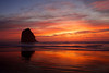 A vibrant sunset percolates through the clouds at Silver Point south of Cannon Beach, Oregon.