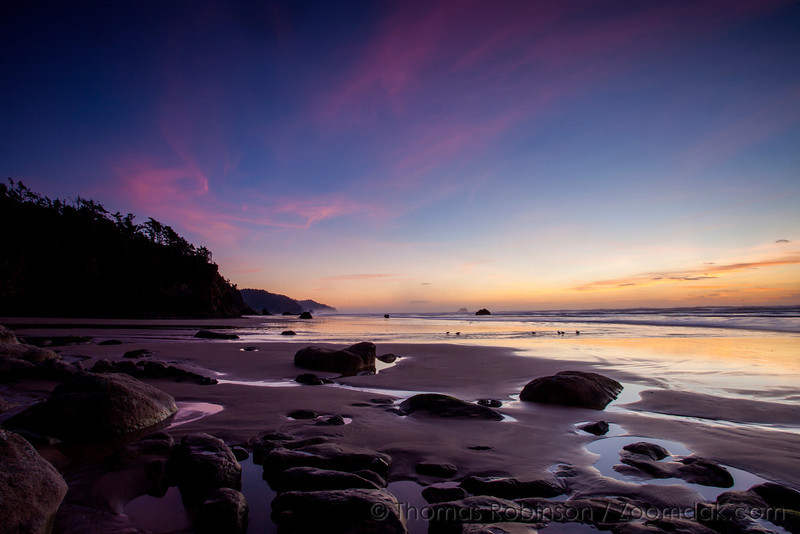 Pink clouds hold the last color of sunset at Hug Point State Park on the Oregon Coast.