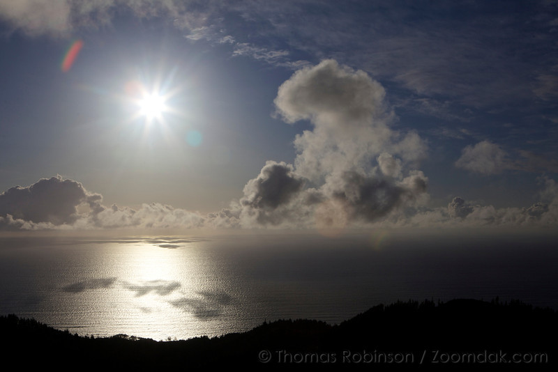 The sun shines out bright above the Pacific Ocean with clouds gathered about. At 63.8 million square mile (165.25 million square kilometres), the largest ocean on Earth covers almost a third of the total surface area.