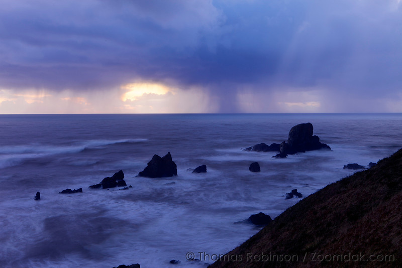 Rain clouds gather off the west coast over the stormy pacific ocean at the Sea Lion Rocks in Ecola State Park.