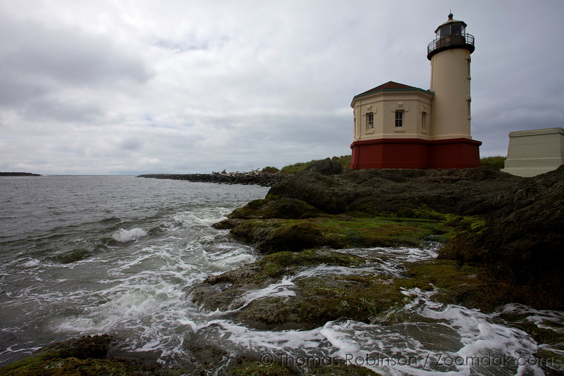 Coquille River Lighthouse stands above the waves at Bullards Beach State Park near Bandon, Oregon.