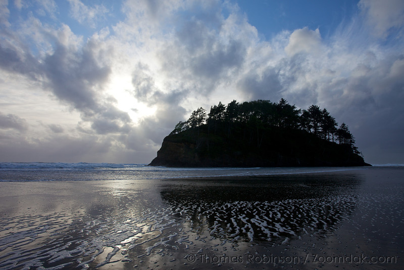 The land monolith island of Neskowin, Oregon reflects in the afternoon light.