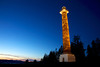 The Astoria Column glows in the evening time. The tower stands 125 feet (38 m) tall and overlooks Astoria and the Columbia River from Coxcomb Hill.