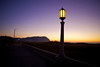 Lamps light up in the twilight glow along the prom in Seaside, Oregon.
