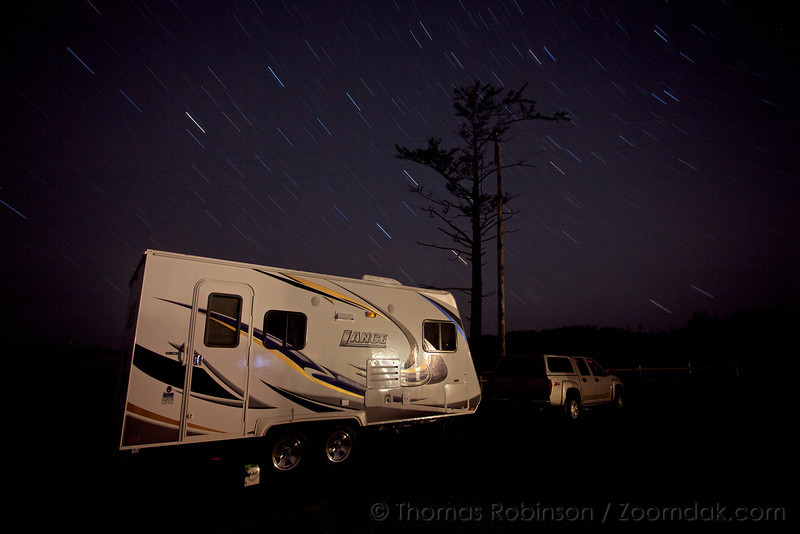 A 12 minute exposure show the trails of the stars above an RV at Cape Lookout on the Oregon Coast.