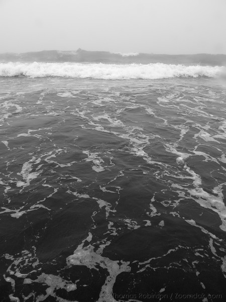 Waves roll into the beach on a foggy day at Indian Beach in Ecola State Park.