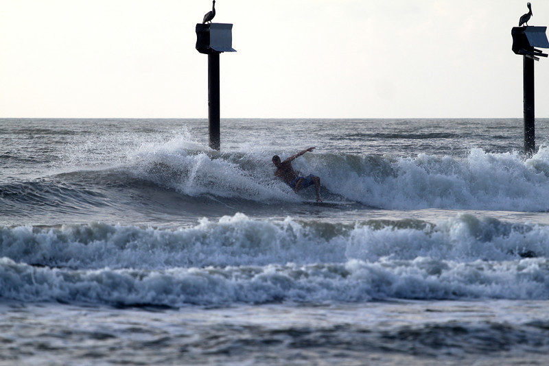 Layback at the pipe in Carolina Beach, NC