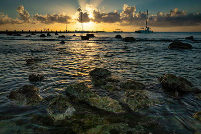 Sunrise along the scenic rocky and beach-lined shores of the beaches of Quintana Roo, Mexico. Located just south of the town of Playa del Carmen is the Barcelo resort. Tucked in a peaceful cove allows guests to escape to tranquility and enjoy a tropical experience.  Photo by Kyle Spradley | © Kyle Spradley Photography | www.kspradleyphoto.com