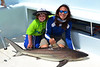 My friend's son, Logan, fishing with Captain Tom at the Cold Mil Fleet - black-tip shark!