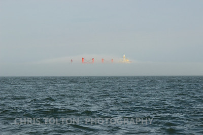 Merchant Ship Displacing the Fog