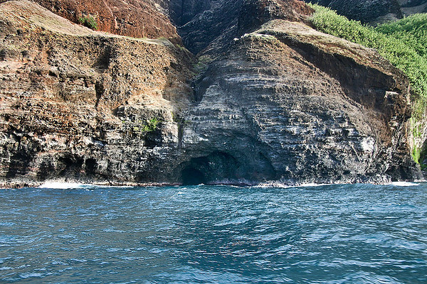 A sea cave cut into the steep cliffs of the headlands of the Napali Coast, northern Kaua'i.