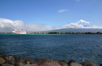 "The cruise ship ""Pride of America"" anchored in Kahului Harbor, Maui. Towering in the background is Haleakala, 10,023 feet high at the summit. FYI: A week after I took this shot (1/29/2008), we got snow on the summit! There was enough that I could see it from my office window, blanketing the peak. Yes, Hortense... it DOES snow in Hawai'i."