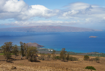 The view of Kaho'olawe island from Ulupalakua, south Maui. The partially submerged cinder cone of Molokini island is visible at the far right of the image.