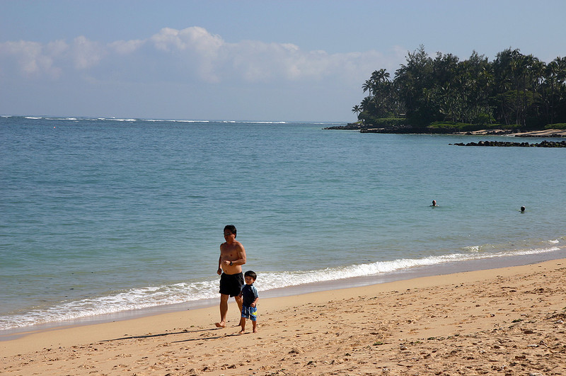 Junior sets the pace for his papa's run. Kanaha Beach, North Maui.