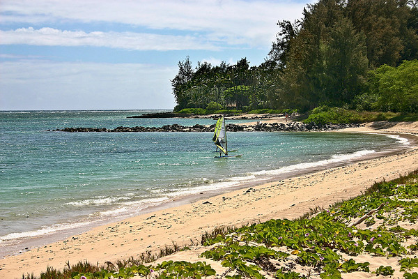 Learning to wind surf in a sheltered portion of Kanaha Beach, north Maui.