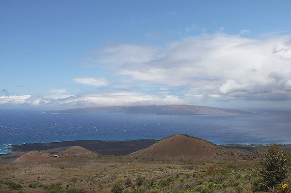 The view of Ahihi Kinau Natural Area Reserve (darker ground along the shoreline is a basaltic lava flow), Pu'u o Kanaloa (a cinder cone in Haleakala's Southwestern Rift Zone), and the island of Kaho'olawe (on the horizon). Photo taken at Ulupalakua, south Maui.