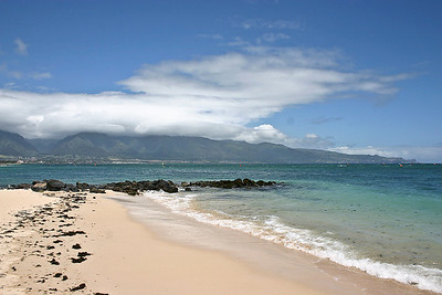 A view of the West Maui Mountains and 'Io Valley (V-shaped valley at far-left of photo) from Kanaha Beach, north Maui.