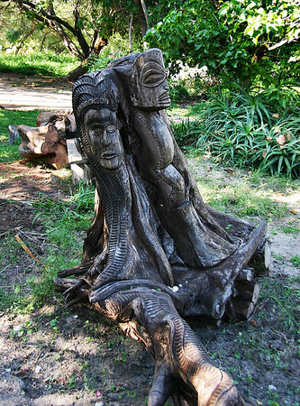 An old tree stump decorated in situ with a pair of rather fine tikis. At the Canoe Hale, Kanaha Beach, Kahului, north Maui.
