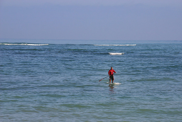 "A ""traditional"" Maui waterman out on the water before the winds bring the big waves. Kanaha Beach, Kahului, north Maui."