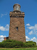 "Twin Lights of the Navesink,a New Jersey State Historic Site<br /> <br /> History of the Navesink Lightstation<br /> <br /> "" …for to the Northward off us we saw high hills. This is a very good land to fall with, and a pleasant land to see"" —Robert Juet, explorer, 1609<br /> <br /> Situated 200 feet above sea level atop the Navesink Highlands, Twin Lights has stood as a sentinel over the treacherous coastal waters of northern New Jersey since 1828. It overlooks the Shrewsbury River, Sandy Hook, Raritan Bay, New York skyline and the Atlantic Ocean. Named Navesink Lightstation, it became known as the ""Twin Lights of Highlands"" to those who used its mighty beacons to navigate. As the primary seacoast light for New York Harbor, it was the best and brightest light on the Atlantic Coast for generations of seafarers. Many a life and cargo were saved by the sweep of its beacons."