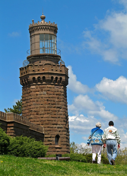 """Twin Lights of the Navesink, a New Jersey State Historic Site<br /> <br /> History of the Navesink Lightstation<br /> <br /> """" …for to the Northward off us we saw high hills. This is a very good land to fall with, and a pleasant land to see"""" —Robert Juet, explorer, 1609<br /> <br /> Situated 200 feet above sea level atop the Navesink Highlands, Twin Lights has stood as a sentinel over the treacherous coastal waters of northern New Jersey since 1828. It overlooks the Shrewsbury River, Sandy Hook, Raritan Bay, New York skyline and the Atlantic Ocean. Named Navesink Lightstation, it became known as the """"Twin Lights of Highlands"""" to those who used its mighty beacons to navigate. As the primary seacoast light for New York Harbor, it was the best and brightest light on the Atlantic Coast for generations of seafarers. Many a life and cargo were saved by the sweep of its beacons."""
