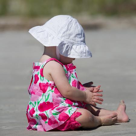 Little girl exploring the beach