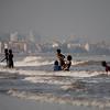 Children enjoying a swim in the Juhu beach in Mumbai