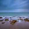 Long exposure of waves over rocks on Caspersen Beach near South Venice, Florida