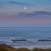 Full moon over paddleboarder on Herring Cove Beach, Provincetown, Cape Cod, Massachusettes