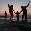 Family enjoying their time together at Aksa beach in Mumbai