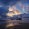 Sunset over rock formations on the beach at Oceanside, Oregon