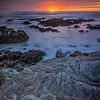 Sunset on rocky shoreline at Asilomar Beach, Monterey County, California