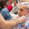 Beacon Hospice and The Atrium at Drum Hill honored their veterans at the facility on Friday Veterans Day. They gave each veteran a pin and a poem to thank them for their service. Giving Marine Private First Class Sabby Ferrante a pin is Daniel Curtis. SUN/JOHN LOVE