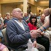 Beacon Hospice and The Atrium at Drum Hill honored their veterans at the facility on Friday Veterans Day. Army Air Core Tech Sgt. George Sorbello gets thanked for his service after getting one of the pins and a poem. SUN/JOHN LOVE