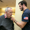 Beacon Hospice and The Atrium at Drum Hill honored their veterans at the facility on Friday Veterans Day. They gave each veteran a pin and a poem to thank them for their service. Giving Navy Lt. Commander William Colbert a pin is Daniel Curtis. SUN/JOHN LOVE