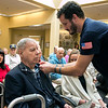 Beacon Hospice and The Atrium at Drum Hill honored their veterans at the facility on Friday Veterans Day. They gave each veteran a pin and a poem to thank them for their service. Giving Marine Sgt. Donald Demole a pin is Daniel Curtis. SUN/JOHN LOVE