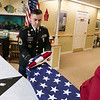 Beacon Hospice and The Atrium at Drum Hill in Chelmsford honored their veterans at the facility on Friday Veterans Day. During the ceremony Army Sgt. 1st Class Nathan Buckley folded a flag to give to the facility to hang on their wall in a triangular box. SUN/JOHN LOVE