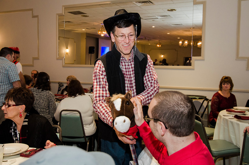 Roger LaPointe acts as a celebrity waiter during the annual Beacon of Hope Harvest Dinner Dance at the Leominster Elks Lodge on Friday evening. SENTINEL & ENTERPRISE / Ashley Green