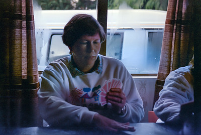 1991 07 183  Debbie playing cards at Ohakune Lodge NEG