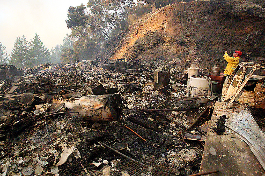 . Officials believe the Bear Fire originated from this burned-out residence surrounded by scorched vehicles along Bear Creek Canyon Road. (Dan  Coyro -- Santa Cruz Sentinel)
