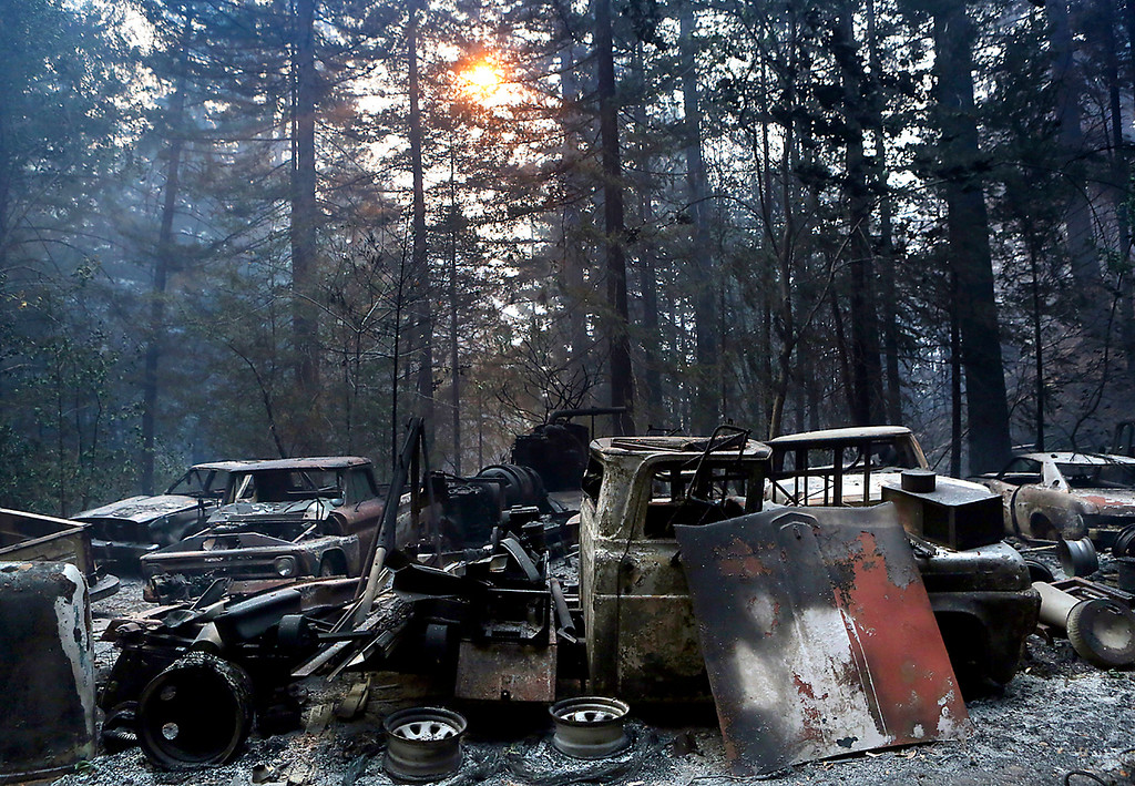 . The burned out frames of vintage cars and trucks are all that remain along Bear Creek Canyon Road where authorities believe the Bear Fire ignited. (Shmuel Thaler -- Santa Cruz Sentinel)