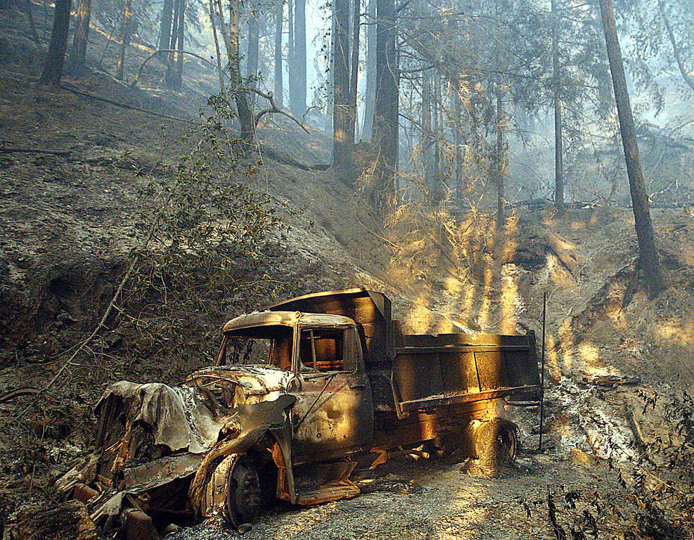. The scorched shell of a dump truck sits on the property where the Bear Fire is believed to have originated. (Dan Coyro -- Santa Cruz Sentinel)