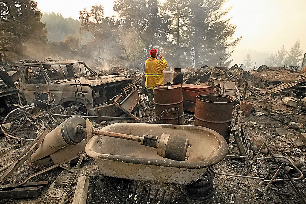 . A house at the end of a road off Bear Creek Canyon Road is totally destroyed along with a number of vehicles, trucks, generators and construction equipment after the Bear Fire roared through in the pre-dawn hours of Tuesday. This property was believed to be the origin of the fire. (Dan  Coyro -- Santa Cruz Sentinel)