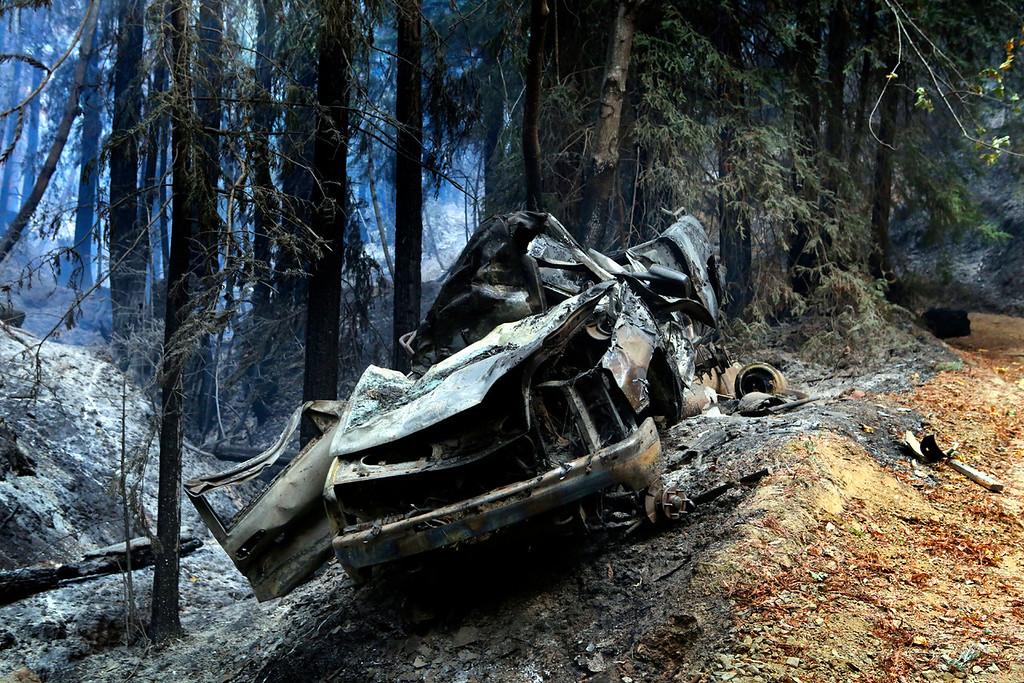 . A vehicle destroyed by the Bear Fire sits near the origin of the blaze. (Shmuel Thaler -- Santa Cruz Sentinel)