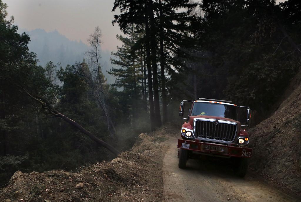 . Cal Fire leads the fight against the Bear Fire off of Bear Creek Road outside of Boulder Creek. (Shmuel Thaler -- Santa Cruz Sentinel)