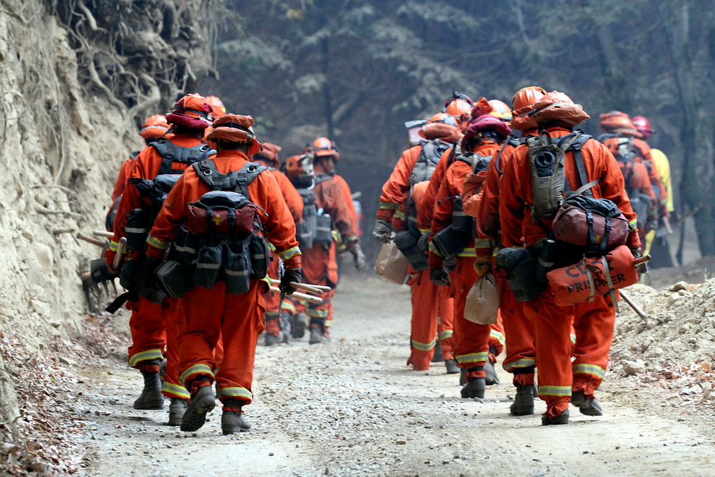 . A California Department of Corrections and Rehabilitation fire crew heads up Bear Creek Canyon Road as they assist on the fire lines Wednesday. (Shmuel Thaler -- Santa Cruz Sentinel)