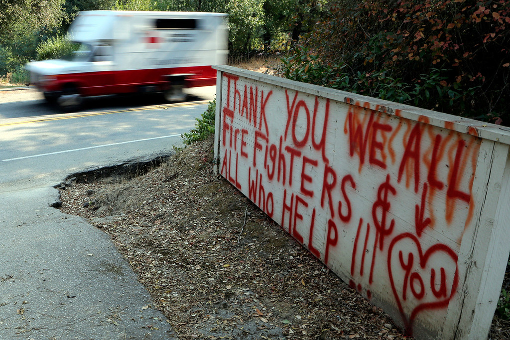 . Well wishes greet firefighters and others responding to the Bear Fire on Bear Creek Road.  (Shmuel Thaler -- Santa Cruz Sentinel)